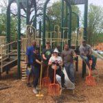 Baxter Square LMPD spread mulch around the playground.