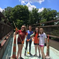 Seneca Park Catholic Heart campers repainted the equestrian bridge to give it a new look.